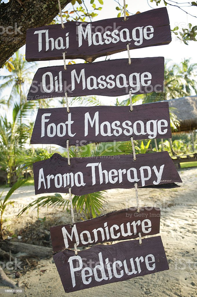 Massage and Aromatherapy Signs Handwritten on the Beach royalty-free stock photo