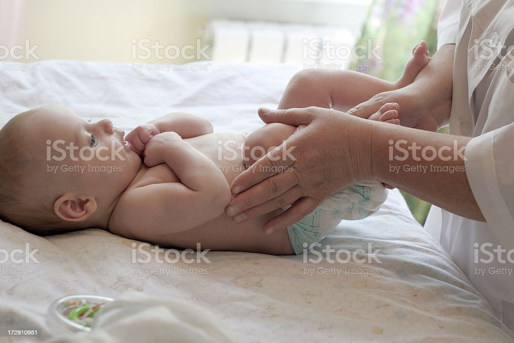 massage and physical training for newborn stock photo