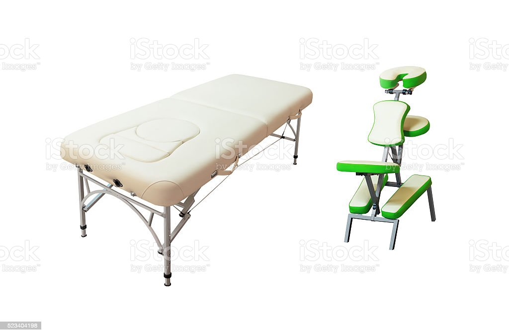 Massage bed and chair stock photo