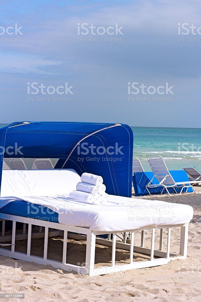 Massage bed at the water edge with towels. stock photo