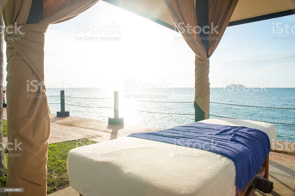 massage bed by the beach stock photo