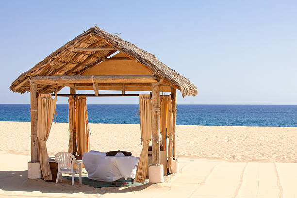 Massage Cabana on a beach with view of ocean stock photo