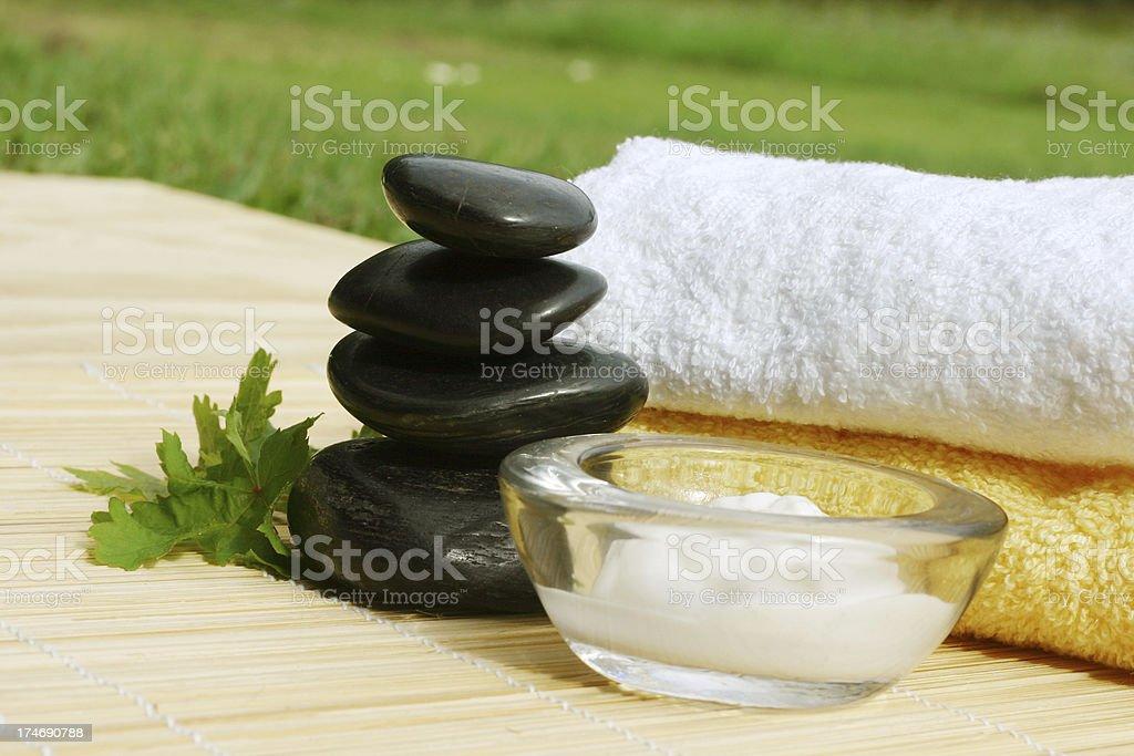 Massage cream, Towels and Balanced Stones royalty-free stock photo