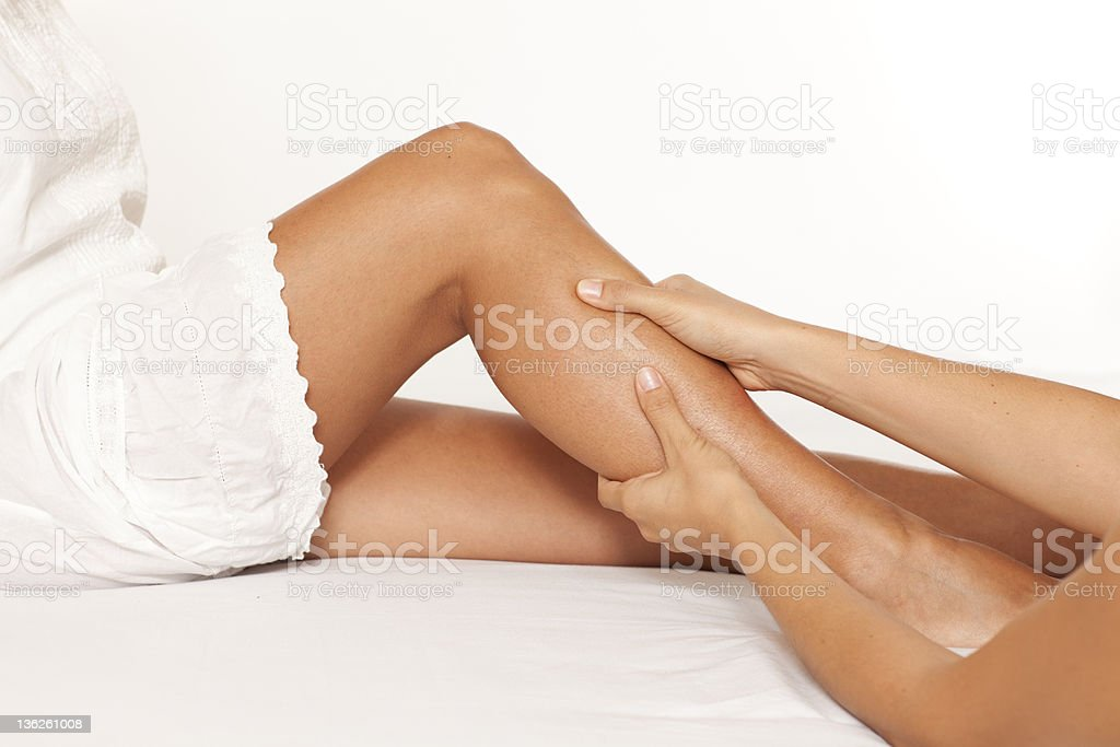 Massage of a female calf muscle royalty-free stock photo