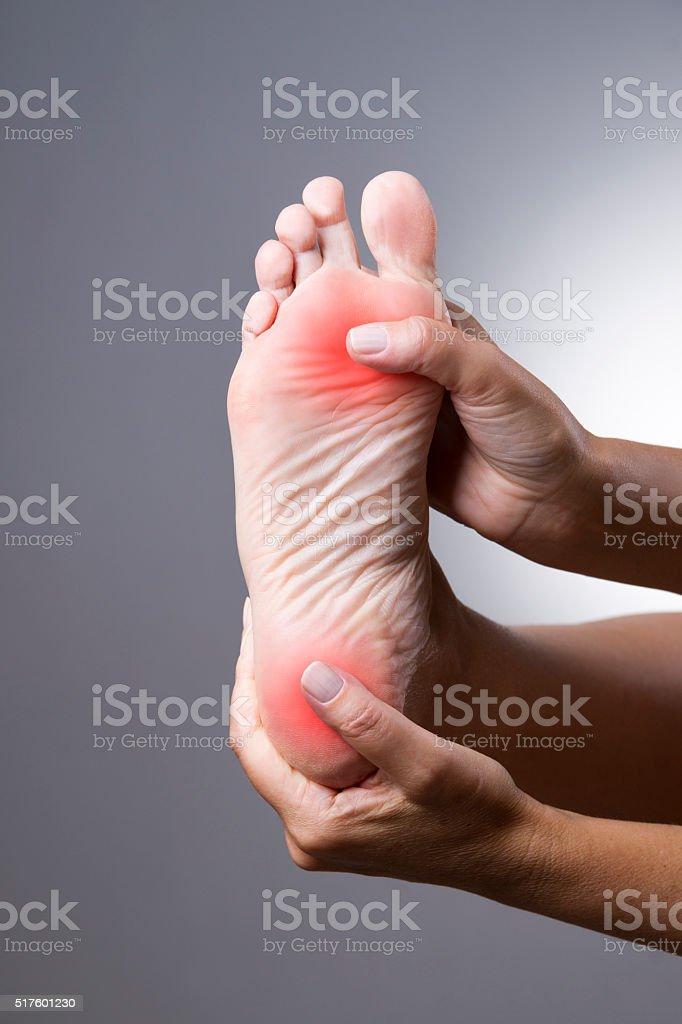 Massage of female feet stock photo