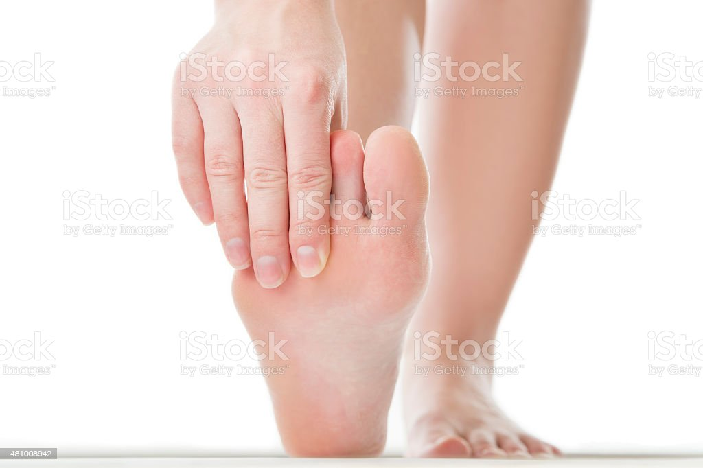 Massage of female foot stock photo