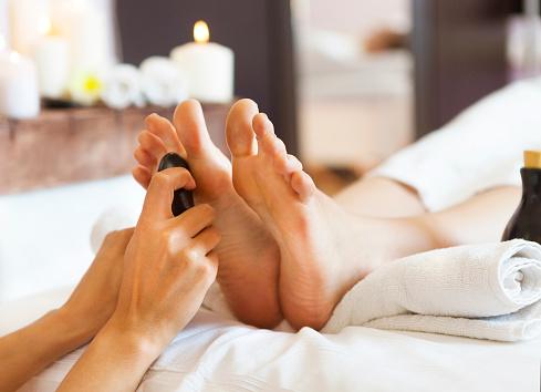 Massage of human feet in spa salon