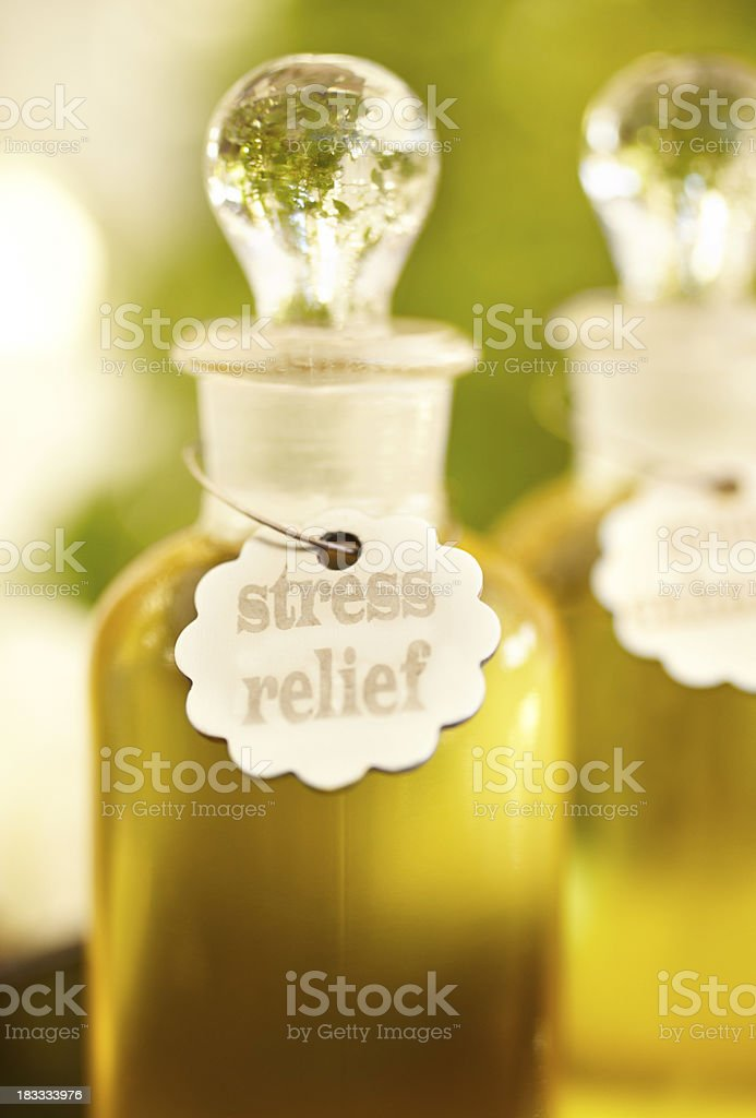 Massage oil and bottles at spa royalty-free stock photo