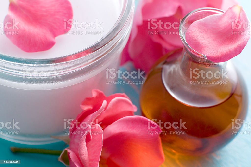 Massage oil and creme jar with roses stock photo