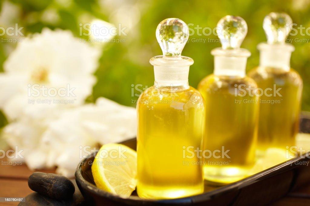 Massage oil bottles at spa stock photo