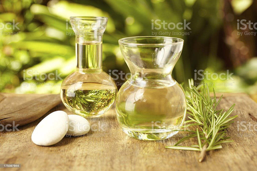 Massage oil bottles at spa with pebble stones outdoors stock photo