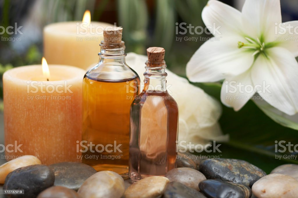 Massage oil, candles and flower royalty-free stock photo