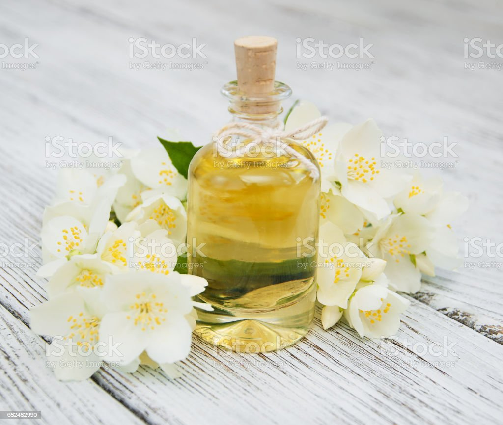 Massage oil with jasmine flowers royalty-free stock photo