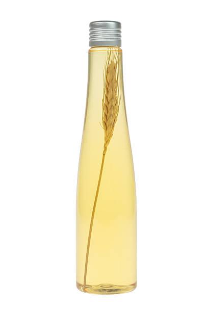 olio per massaggio con grano in bottiglia - oli, aromi e spezie foto e immagini stock