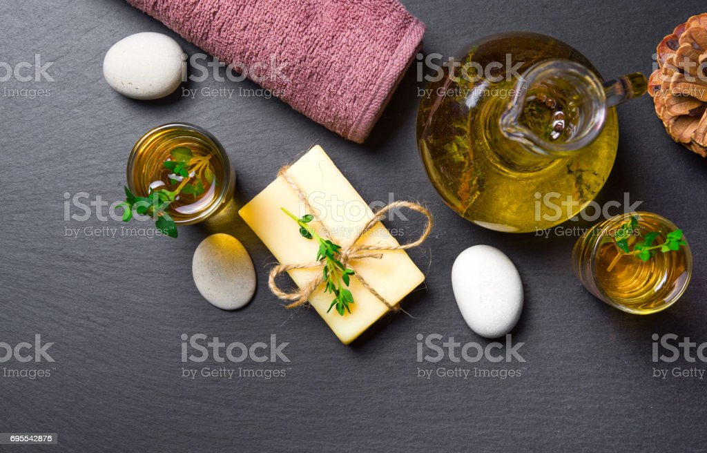 Massage or aromatherapy set: oil, stones, soap and towel stock photo