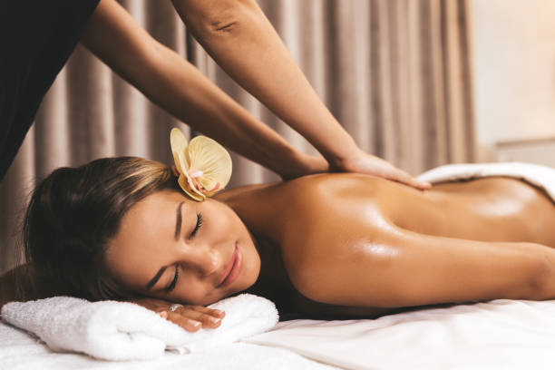 Massage Beautiful young woman relaxing with hand massage at beauty spa massaging stock pictures, royalty-free photos & images
