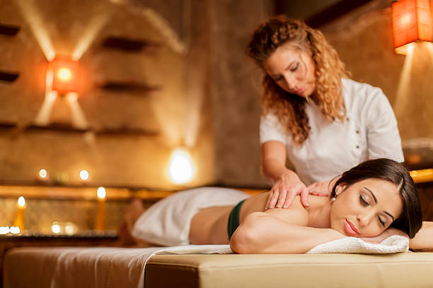 massage - massage therapist stock pictures, royalty-free photos & images