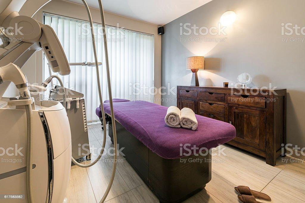 Massage room interior in wellness center stock photo