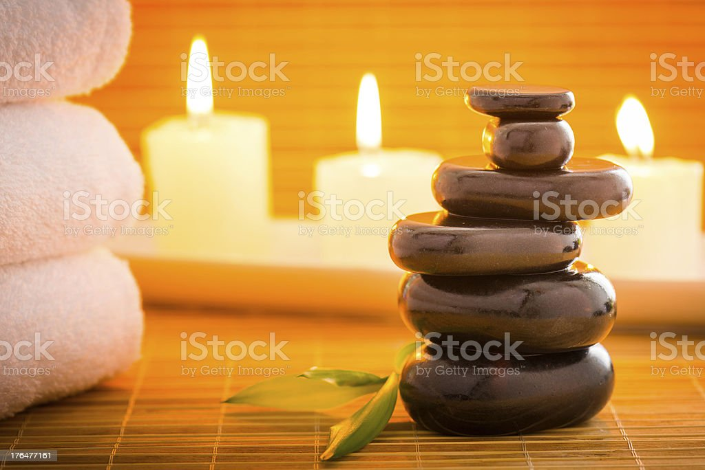 Massage stones and candles royalty-free stock photo