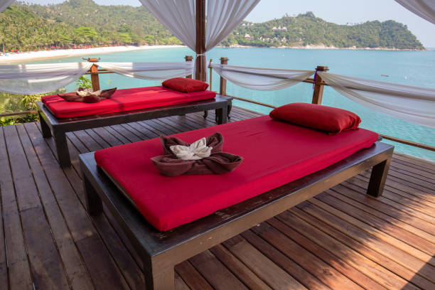 Massage table overlooking the sea. Spa massage room on the beach in Thailand stock photo