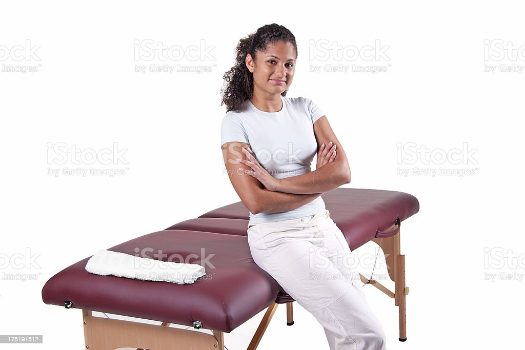 Massage table with proud masseuse stock photo