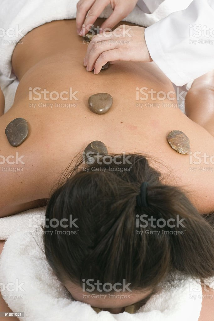 Massage - therapeutic stones placement royalty-free stock photo