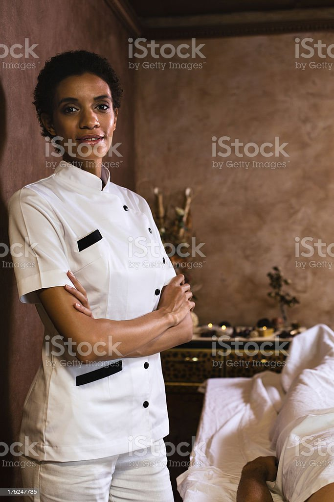 Massage therapist in beauty center royalty-free stock photo