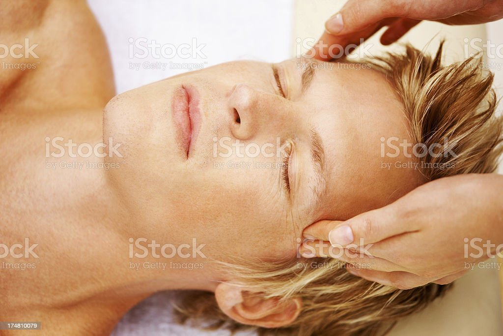 Massage therapy alleviating tension royalty-free stock photo