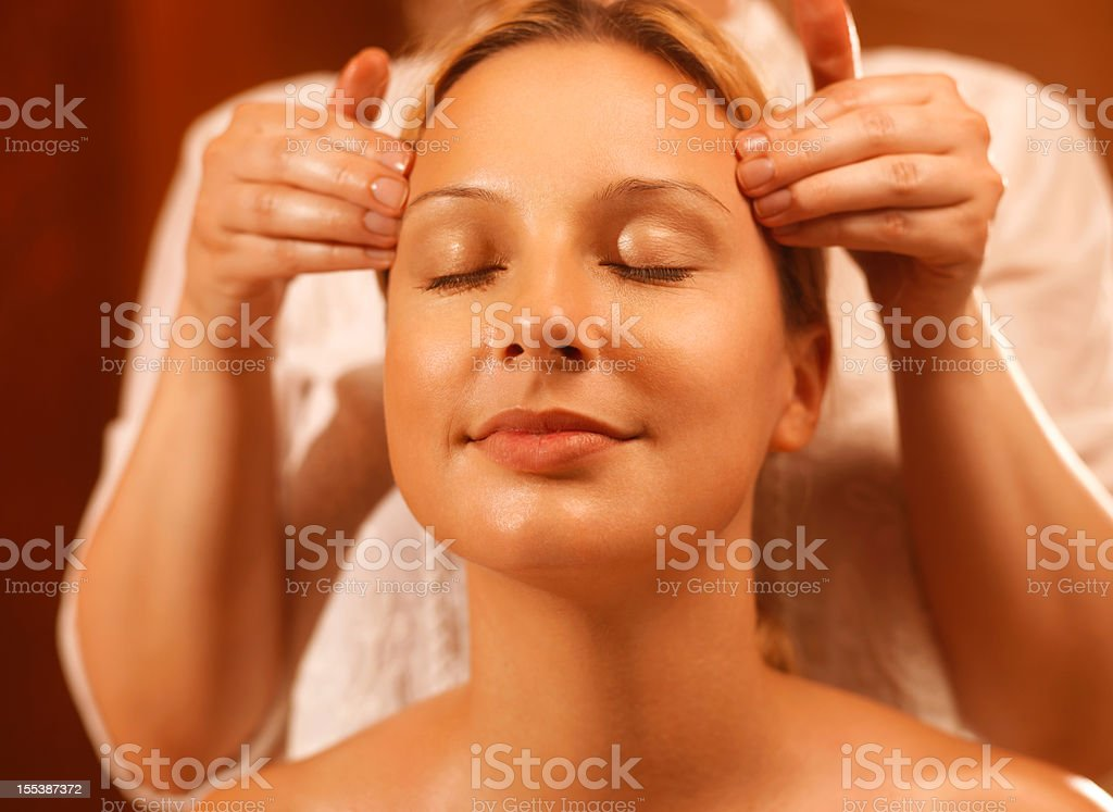 massage treatment for temples stock photo