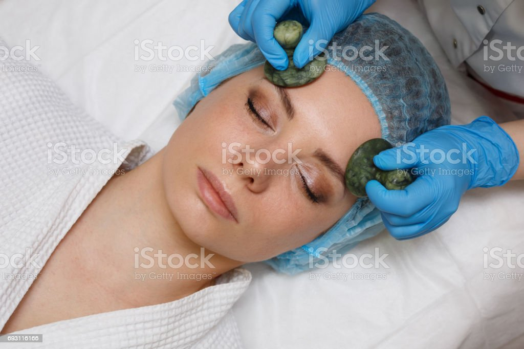 Massage with jade stones. Gua sha stock photo