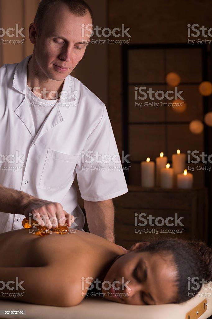 Massage with massage equipment photo libre de droits