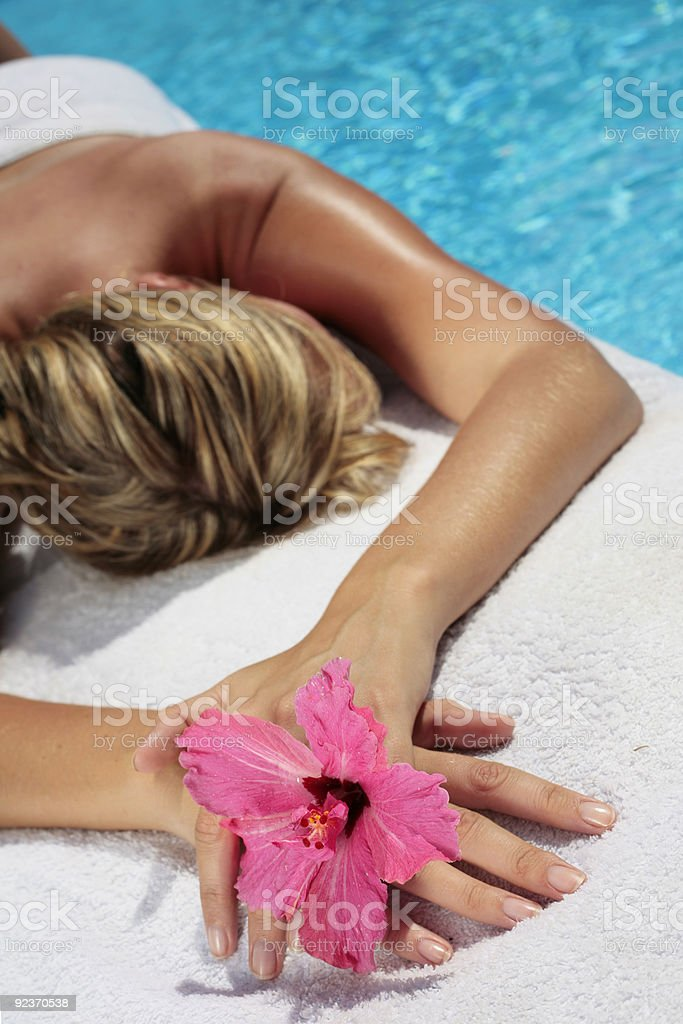 Massage woman with flower royalty-free stock photo