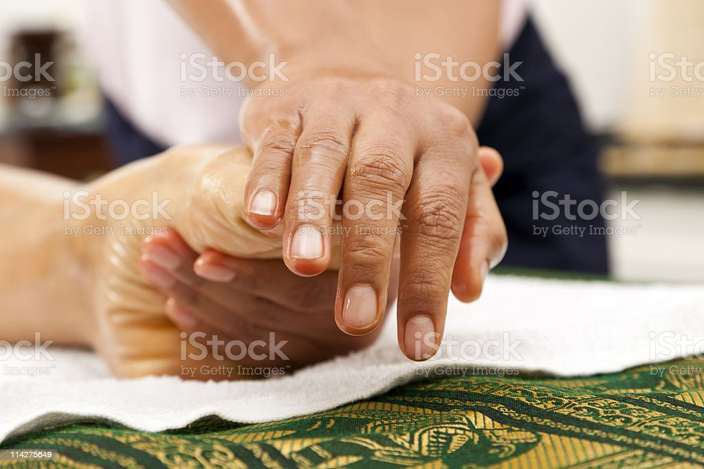 massaging a foot royalty-free stock photo