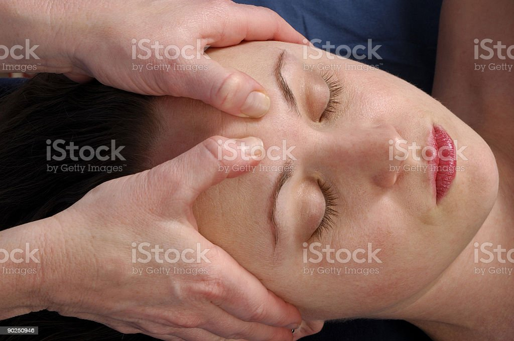 Massaging Forehead at Wellness Center royalty-free stock photo