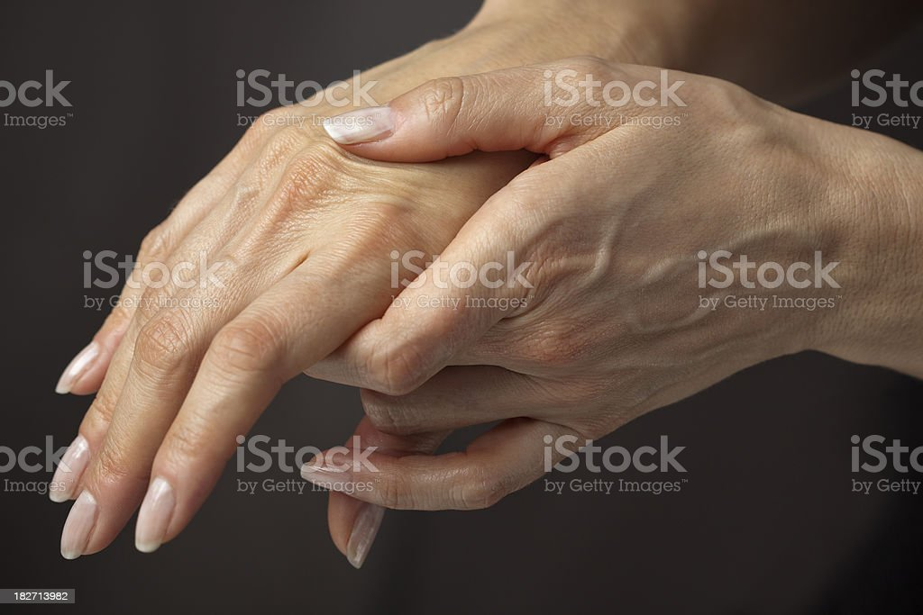 Massaging hands in pain stock photo
