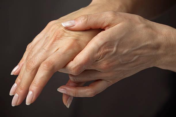 Massaging hands in pain stock photo