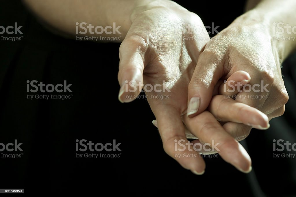 Massaging hands in pain royalty-free stock photo