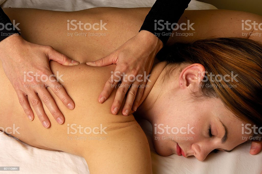 Massaging Shoulder at Mind and Body Boutique royalty-free stock photo