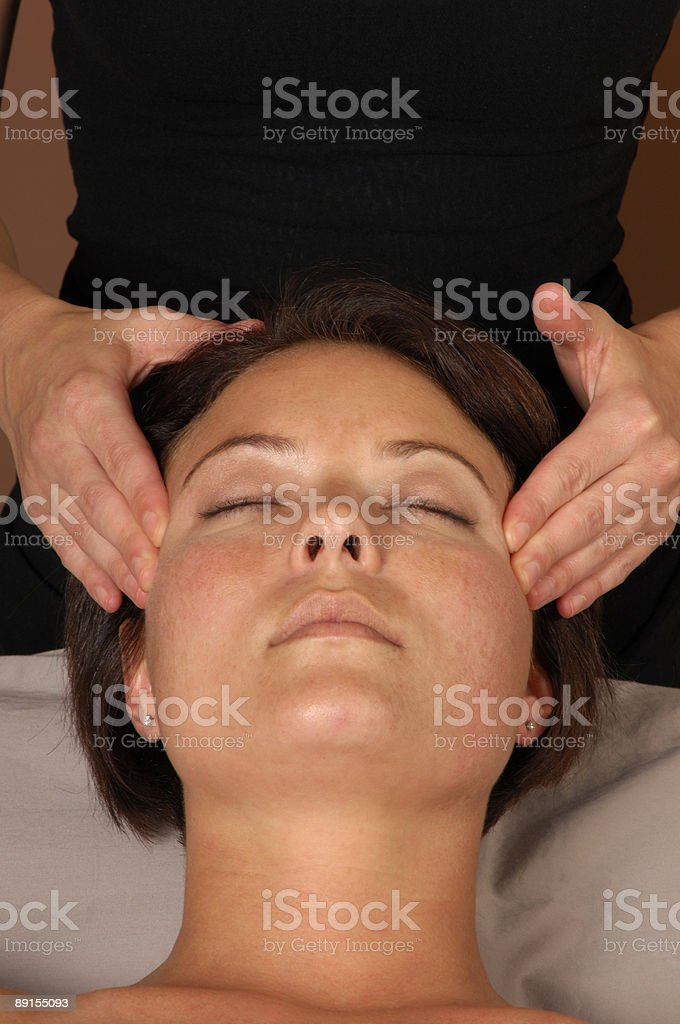 Massaging Temples at Day Spa royalty-free stock photo