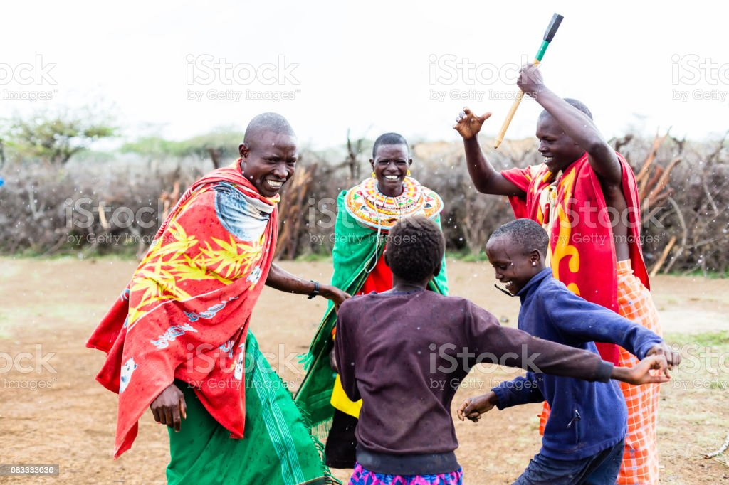 Massai family celebrating and dancing stock photo