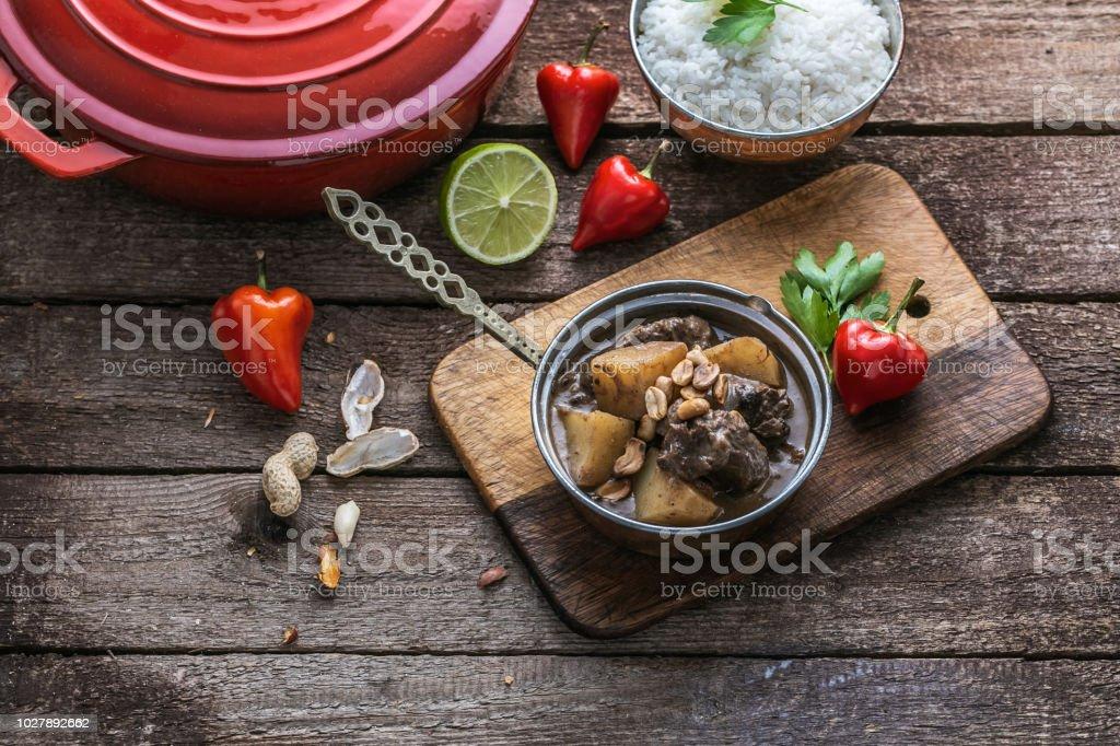 Massaman curry: beef, potato, peanuts and coconut. stock photo