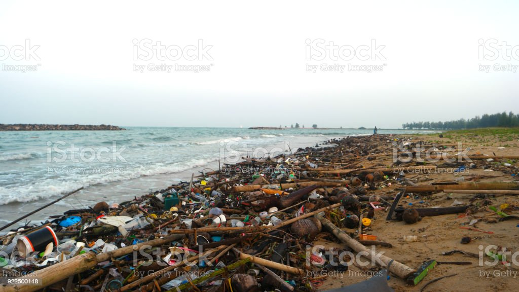 Masses of rubbish along the coastline litter the once beautiful sandy beach stock photo