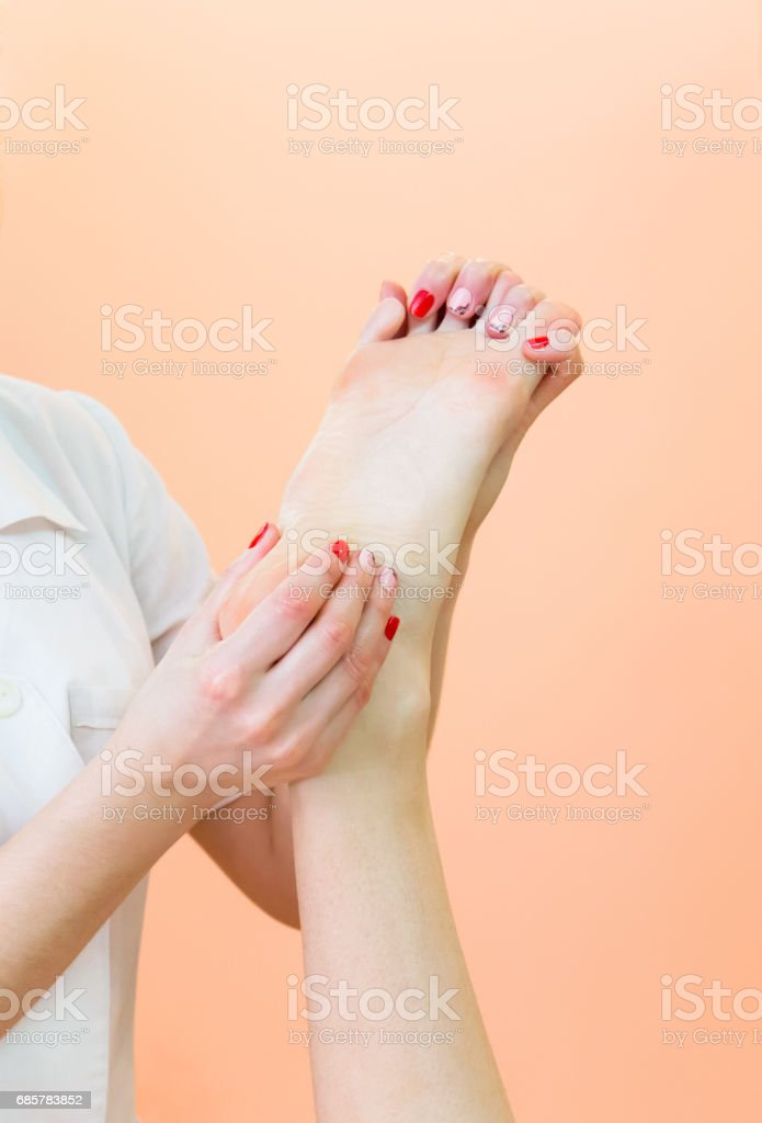Masseur kneads the foot client. royalty-free stock photo