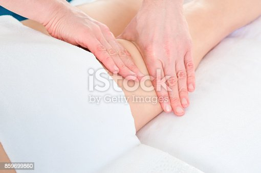 istock masseur makes anti-cellulite massage young woman on white background 859699860