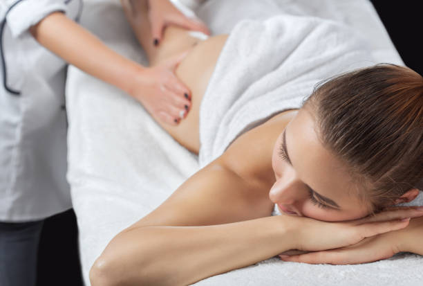 Masseur makes anti-cellulite massageon the legs, thighs, hips and buttocks in the spa. Overweight treatment, body sculpting.Cosmetology and massage concept. stock photo