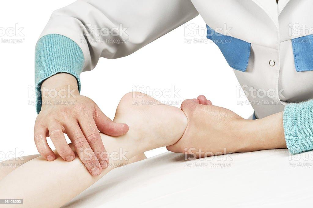 Masseur massaging a child leg royalty-free stock photo