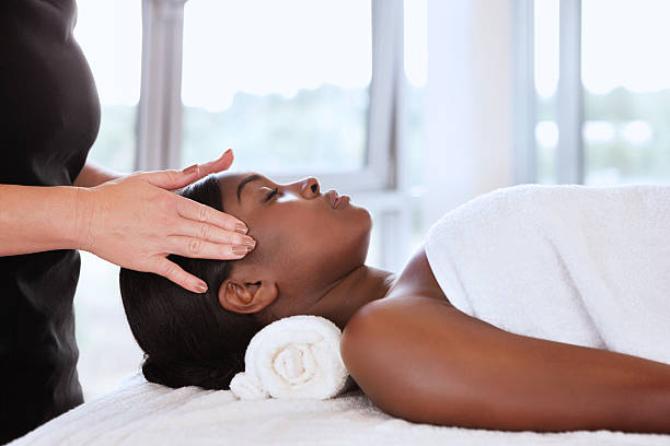 massage giving reiki head masseuse therapist woman spa treatment getty