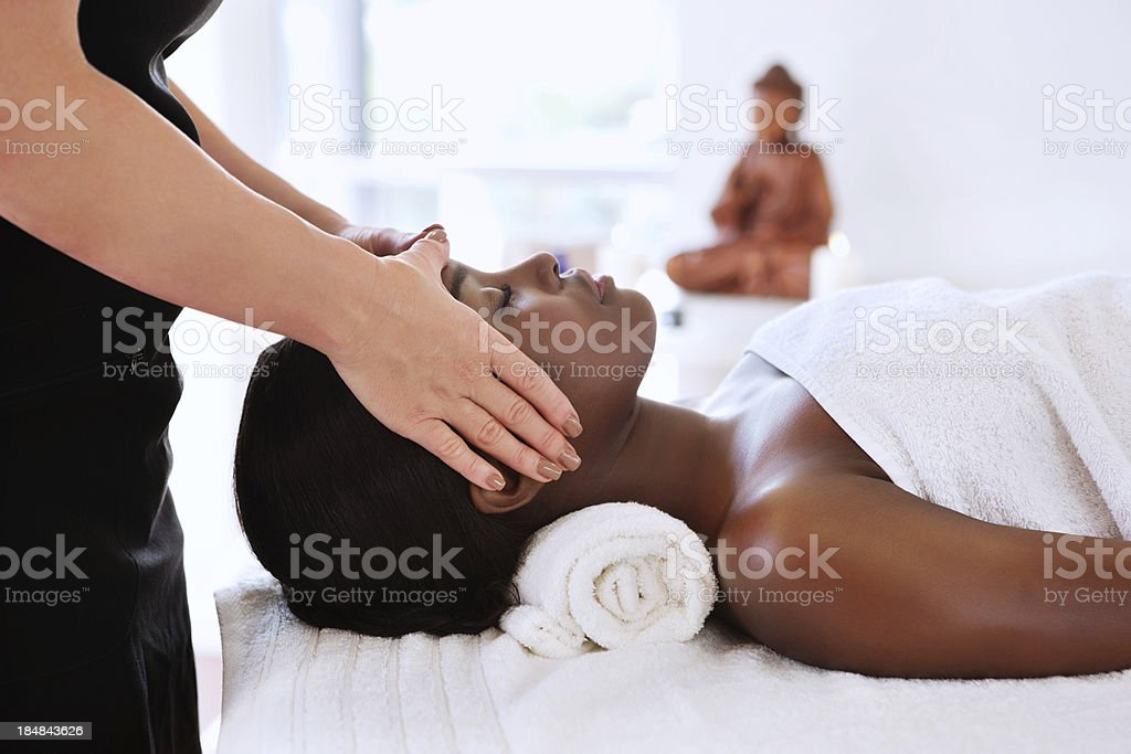Masseuse Giving a Head Massage stock photo