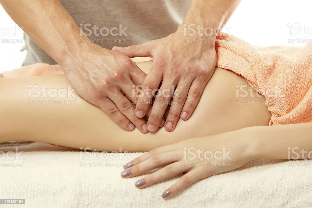 Masseuse performing anti-cellulite massage on a young woman royalty-free stock photo