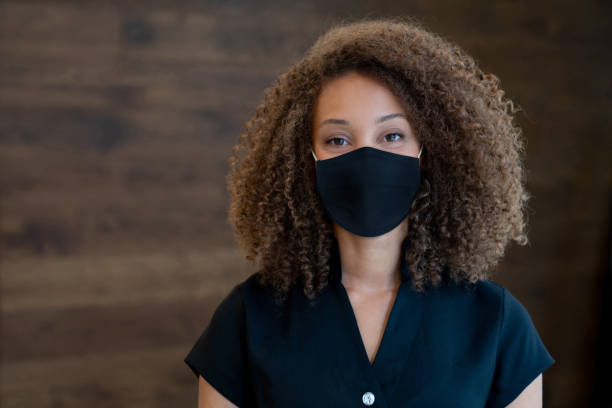 Masseuse working at a spa and wearing a facemask stock photo
